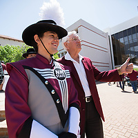 Garrey Carruthers, president and chancellor of New Mexico State University, poses for pictures with Zach Barraza, who is wearing the 2018-2019 The PRIDE of New Mexico Marching Band Uniform, during the Fourth Annual Founders Day Celebration at NMSU, Friday April 20, 2018. This years theme is to celebrate the musical traditions of NMSU, including the PRIDE of New Mexico Marching Band, the Aggie Fight Song as well as members of the marching band wearing uniforms from the past 40 years.