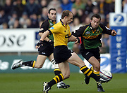 Northampton, Northamptonshire, 2nd October 2004 Northampton Saints vs London Wasps, Zurich Premiership Rugby, Franklyn Gardens, [Mandatory Credit: Peter Spurrier/Intersport Images],<br /> Matt Dawson, kicks clear as Corne Krige attempts to block the clearence.