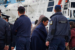 A Refugee, escorted by the European border control agency Frontex personnel, is to board a vessel at Mytilene port in Greece, on April 8, 2016. A total of 124 refugees and migrants were returned to Turkey from Greek islands on Friday, the second of such mission in a week under the EU-Turkey deal to cope with the refugee crisis. EXPA Pictures © 2016, PhotoCredit: EXPA/ Photoshot/ Anthi Pazianou<br /> <br /> *****ATTENTION - for AUT, SLO, CRO, SRB, BIH, MAZ, SUI only*****