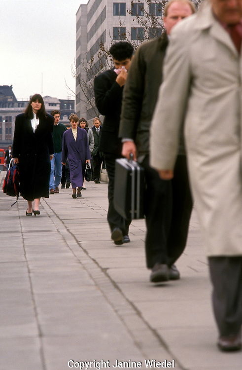 Commuters going into work in the city london.