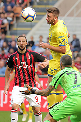 October 7, 2018 - Milan, Milan, Italy - Luca Rossettini #15 of AC Chievo Verona competes for the ball with Gonzalo Higuain #9 of AC Milan during the serie A match between AC Milan and Chievo Verona at Stadio Giuseppe Meazza on October 7, 2018 in Milan, Italy. (Credit Image: © Giuseppe Cottini/NurPhoto/ZUMA Press)