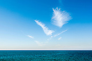 Cirrus clouds over Mediterranean Sea on a sunny day in winter