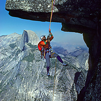 ROCK CLIMBING. Allan Pietrasanta (MR) climbing  rope to Glacier Point, Yosemite NP. Half Dome bkg.