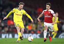 FC BATE Borisov's Aleksandr Hleb (left) and Arsenal's Denis Suarez battle for the ball during the UEFA Europa League round of 32 second leg match at the Emirates Stadium, London.