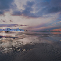 The horizon seemed to melt away as an arctic sunset slowly took away all the colors from the sky.