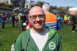 Edinburgh, UK. 28 April, 2018. Hundreds of cyclists take part in the Pedal to Parliament demonstration to highlight lack of investment in cycling infrastructure in Scotland. Starting at The Meadows park they rode along the Royal Mile in the Old Town to a rally held outside the Scottish Parliament in Holyrood. Photo shows Patrick Harvie co-convener of the Scottish Green Party