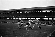 21/10/1962<br /> 10/21/1962<br /> 21 October 1962<br /> Oireachtas Final: Tipperary v Waterford at Croke Park, Dublin.<br /> Tipperary forward, J. Moloughlin, hits the ball towards the net as N. Power, the Waterford goalie, looks on in anguish. The ball rolled narrowly wide.