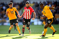 Southampton's Charlie Austin (centre) and Wolverhampton Wanderers' Willy Boly (right) in action during the Premier League match at Molineux, Wolverhampton.