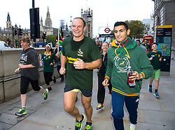 © London News Pictures. 24/10/2015. London, UK. Captain of the 1995 South African Rugby World Cup winning team, FRANCOIS PIENAAR (centre), takes part in an early morning, 2 mile run around westminster to mark the anniversary of in the 1995 winning team going for a morning jog. The event takes place on the morning of the Rugby World Cup semi-final between South Africa and New Zealand. Photo credit: Ben Cawthra /LNP