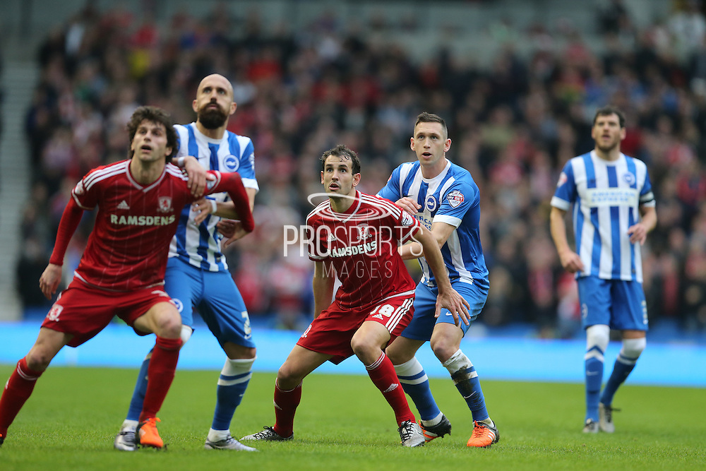 Middlesbrough FC striker Christian Stuani holds off Brighton central midfielder, Andrew Crofts (8) during the Sky Bet Championship match between Brighton and Hove Albion and Middlesbrough at the American Express Community Stadium, Brighton and Hove, England on 19 December 2015.