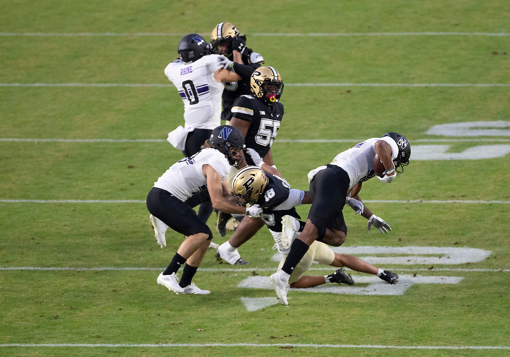 November 14, 2020:  Purdue defensive back Cam Allen (18) trips up Northwestern wide receiver Kyric McGowan (8) during NCAA football game action between the Northwestern Wildcats and the Purdue Boilermakers at Ross-Ade Stadium in West Lafayette, Indiana. Northwestern defeated Purdue 27-20.  John Mersits/CSM.