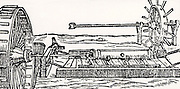Boring cannon. In the left foreground is a two-man treadmill and in the right background is a handmill.   From 'De la pirotechnia' by Vannoccio Biringuccio (Venice, 1540). Woodcut.