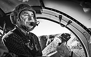 Skilled chopper pilot looks for good spot to set the machine down by river's edge