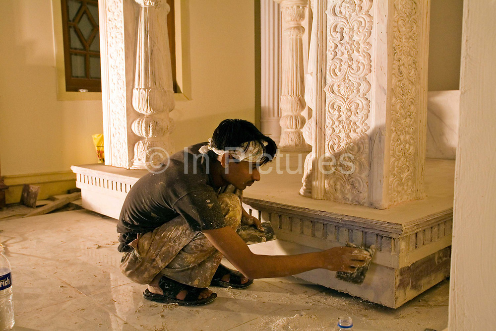 Stagehands paint and decorate a film set in a studio, Mumbai, India<br /> <br /> The Merchants of Bollywood, An Indian theatrical dance musical, charts the history of the world's largest and most prolific film industry, and is loosely based on the showbusiness, Merchant family. Seen by over two million people worldwide, the show is homage to the world of Indian cinema.