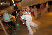 A day at sea aboard the Royal Clipper. Jens, Head of Sports Team, dancing dirty with passengers.