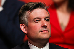 © Licensed to London News Pictures. 09/05/2017. Manchester, UK. Shadow health secretary Jonathan Ashworth watches on as Labour Leader Jeremy Corbyn addresses supporters and the media at a rally in Manchester to launch the party's general election election campaign. Photo credit : Ian Hinchliffe/LNP