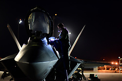 An F-22 Raptor pilot with the 95th Fighter Squadron performs a preflight inspection prior to night flying operations at Tyndall Air Force Base, Fla., June 11, 2018. (U.S. Air Force photo by Airman 1st Class Isaiah J. Soliz)