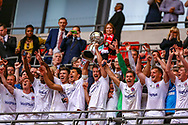 AFC Flyde hold the cup aloft after the FA Trophy final match between AFC Flyde and Leyton Orient at Wembley Stadium on 19 May 2019.