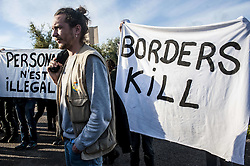 October 27, 2016 - Calais, France - A press conference is held on the sidelines of the jungle by the associations. The police pushes the protesters hold banners against border at Calais, October 27, 2016..The Calais jungle begins its fourth day of dismantling. Most refugees have left the jungle. Some roam the jungle and over 100 young refugees have no place in the Provisional Home Centre. The workers are destroying the jungle growing rapidly. (Credit Image: © Julien Pitinome/NurPhoto via ZUMA Press)