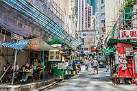 Central, Hong Kong, China - June 4, 2014: people and restaurants in Elgin Street at Soho