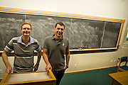 """Visiting Professors Srdja Popovic and Slobodan Djinovic pose for a picture in the Kallaus Lecture Hall in ARH on Friday. Popovic and Djinovic co-instructed a course this Fall entitled """"Non-Violent Actions and Strategies."""""""