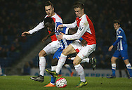 Brighton striker Elvis Manu is sandwiched by Arsenal defender Callum Chambers and Arsenal midfielder Ben Sheaf during the Barclays U21 Premier League match between Brighton U21 and Arsenal U21 at the American Express Community Stadium, Brighton and Hove, England on 30 November 2015. Photo by Bennett Dean.
