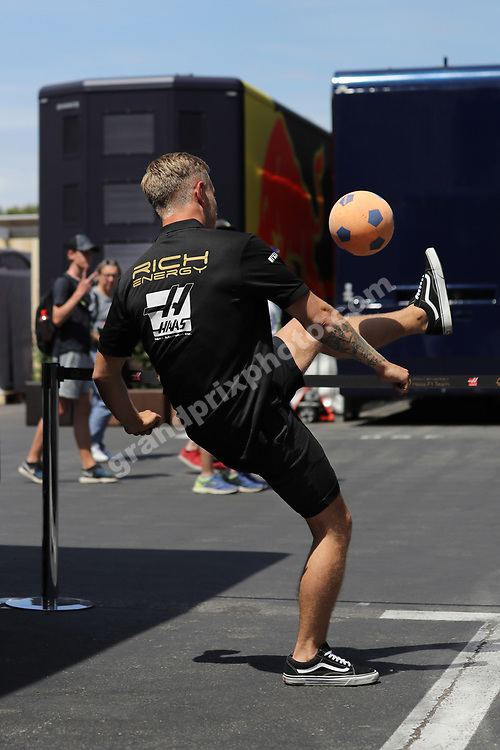 Kevin Magnussen (Haas-Ferrari) playing football in the paddock before the 2019 French Grand Prix at Paul Ricard. Photo: Grand Prix Photo