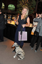 PHILIPPA HOLLAND and her dog Zola at a party to celebrate the launch of Carol Woolton's book 'Drawing Jewels For Fashion' held at Asprey, 167 New Bond Street, London W1 on 10th November 2011.