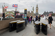 Families pass through the new anti-vehicle security barriers located on the southern (Lambeth) end of Westminster Bridge, on 6th September 2017, in London, England.