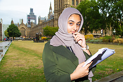 Sixteen year-old Anam Ahmedi from King's Heath in Birmingham who wrote an open letter to Boris Johnson following his article where he compared Muslim women in Bukas and Hijabs to 'letterboxes' and 'bank robbers', is pictured outside the Houses of Parliament in Westminster. London, August 10 2018.
