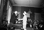 28/04/1966<br /> 04/28/1966<br /> 28 April 1966<br /> President Eamon de Valera presents prizes at Aras an Uachtarain. The President presented the prizes to the winners of competitions for schoolchildren organised by the Golden Jubilee 1916 Committee. The winners from schools all over Ireland competed in competitions for essays and poetry in Irish and English. Picture shows President de Valera presenting 2st prize of £30 in competition of original poem in English (under18) to Karola Grimmer, Mount Argus, Sydney Park, Cork, a pupil of Scoil Mhuire, Sydney Place, Cork.