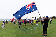 The national flag of Australia is seen being waved by a demonstrator as they gather at St. Kilda Beach during the Sack Daniel Andrews Protest in Fawkner Park. Parts of the community are looking to hold the Victorian Premier accountable for the failings of his government that led to more than 800 deaths during the Coronavirus crisis. Victoria has recorded 36 days Covid free as pressure mounts on the Premier Daniel Andrews to relax all remaining restrictions. (Photo by Mikko Robles/Speed Media)