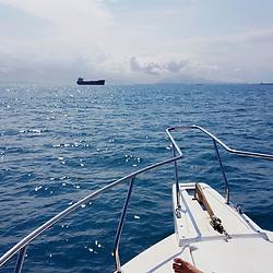 """""""Barco no oceano (Paisagem) fotografado em Vitória, Espírito Santo -  Sudeste do Brasil. Oceano Atlântico. Registro feito em 2016.<br /> <br /> ENGLISH: Boat in the ocean photographed in Vitória, Espírito Santo - Southeast of Brazil. Atlantic Ocean. Picture made in 2016."""""""