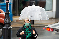 ©Licensed to London News Pictures 29/10/2020  <br /> Blackheath, UK. Wet weather for shoppers in Blackheath Village, London. October is set to be the wettest month in years as an Atlantic storm brings wet and windy weather to parts of the UK today. Photo credit:Grant Falvey/LNP
