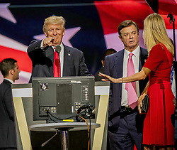 October 30, 2017 - (File Photo) - Donald Trump's former presidential campaign manager, PAUL MANAFORT, has been charged on 12 counts, including conspiring to defraud the US in his dealings with Ukraine. The 12 charges brought against Mr Manafort and one of his business associates, Rick Gates, include conspiracy to launder money. They stem from an inquiry into alleged Russian meddling in the US election. PICTURED: July 21, 2016 - Cleveland, Ohio, U.S - DONALD TRUMP, PAUL MANAFORT Trump campaign manager and IVANKA TRUMP during the sound checks  on stage in the Quicken Arena for the Republican National Convention. (Credit Image: © Mark Reinstein via ZUMA Wire)