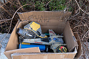 The discarded possessions of a young boy, part of a winters decluttering, consists of Star War model toys including a Light Sabre and Star Fighter, in a box for passers-by to take for free from a wall outside a residential home in Herne Hill, south London, on 28th January 2021, in London, England.