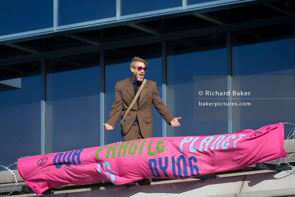 An environmental activist protest about Climate Change during the occupation of City Airport (London's Business Travel hub) in east London, the fourth day of a two-week prolonged worldwide protest by members of Extinction Rebellion, on 10th October 2019, in London, England.