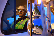 Lineman inside the cab of his truck at dusk before starting work on a down electrical line