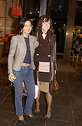 Yasmin Mills and Miss D. Re-opening of Mulberry. New Bond St. London. 23 October 2001. © Copyright Photograph by Dafydd Jones 66 Stockwell Park Rd. London SW9 0DA Tel 020 7733 0108 www.dafjones.com