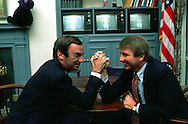A 27.7 MG IMAGE OF:. ABC correspondent  Sam Donaldson and White House press secretary larry Speakes doing hand wrestling in Speakes office in the White House.  Photo by Dennis Brack
