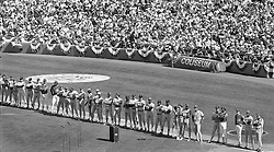 All-Star players line up before a sell out crowd at the Oakland Alameda-County Coliseum before the 1987 All-Star game. (photo/Ron Riesterer)