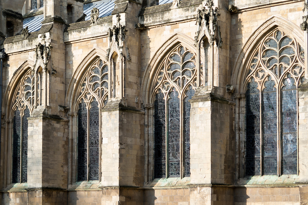 14th century tracery of the Decorated style (leaf motif) in the south aisle of Beverley Minster interspersed with buttresses.