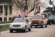 """06 DECEMBER 2020 - DES MOINES, IOWA: People drive past the Iowa State Capitol during a motorcade in support of President Donald Trump. About 1,000 supporters of outgoing US President Donald Trump rallied in Des Moines Sunday to show their support for the President and to protest the outcome of the US Presidential election. They started with a rally in the suburbs of Des Moines then drove in a motorcade through the city, ending at the State Capitol. They repeated many of Trump's discredited claims that the election was marked by fraud and that Trump actually won. The protest was a part of the national """"March for Trump"""" effort, culminating in a march in Washington DC on December 13. Joe Biden won the election, with 306 electoral votes to Trump's 232.       PHOTO BY JACK KURTZ"""