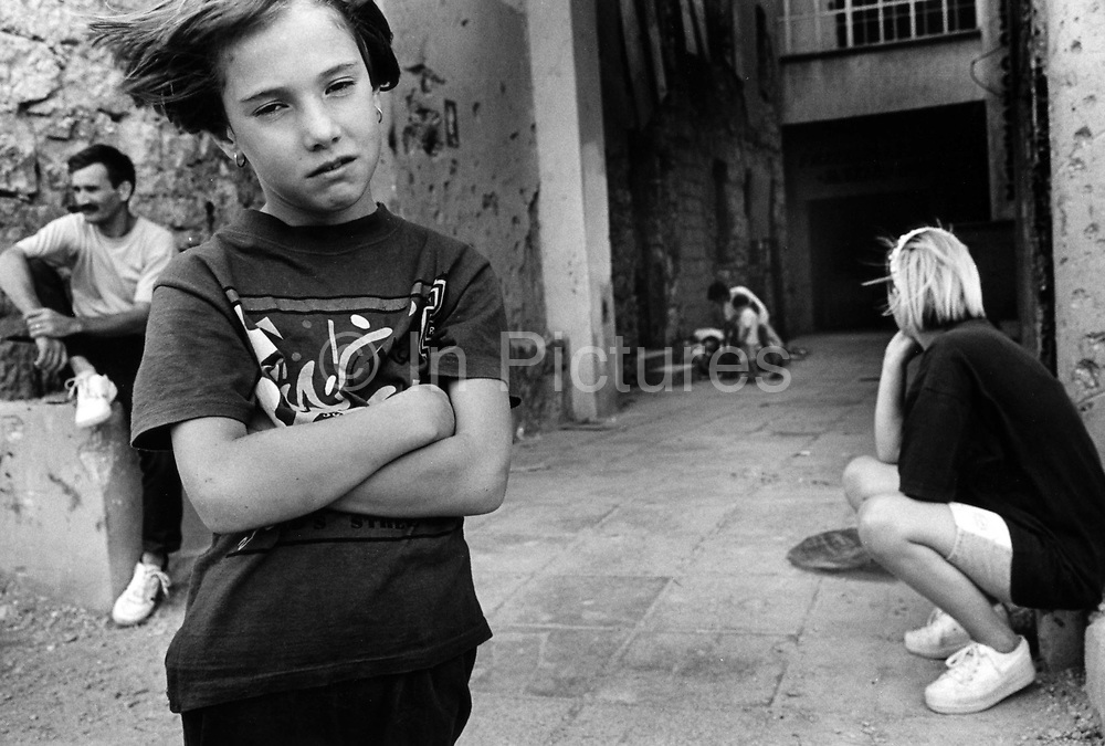 "Children showing signs of trauma after the brutal Muslim Croat War.  It was destroyed by systemic bombardment from Croat guns during the Croat Muslim War, when the Croats endeavored to "" cleanse"" the town of non Croats. Mostar, Bosnia and Herzegovina."