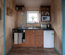 Interior  of new wooden houses at the Social Bite Village in Granton built by Social Bite organisation for homeless people, Edinburgh, Scotland, United Kingdom, UK