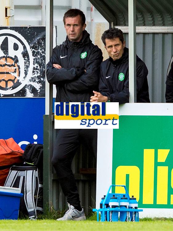 16/07/14 UEFA CHAMPIONS LEAGUE 2ND RND QUALIFIER<br /> KR REYKJAVIK v CELTIC<br /> KR-VOLLUR STADIUM - REYKJAVIK<br /> Celtic manager Ronny Deila (left) with assistant John Collins