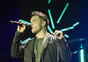 """Westlife Greatest Hits / Farewell Tour 2012 at the Metro Radio Arena Newcastle..15-06-12... ..Shane Filan of Irish Super Group Westlife perform during their sell out show at the Metro Radio Arena, in the English Leg of their Greatest Hits / Farewell World Tour. ..Westlife are an Irish boy band formed in 1998. They are to disband in 2012 after their farewell tour. The group's line-up was Shane Filan, Mark Feehily, Kian Egan, and Nicky Byrne. Brian McFadden was part of the group until 2004. Westlife have sold over 45 million records worldwide which includes studio albums, singles, video release, and compilation albums.. Despite the group's worldwide success, they only have one hit single in the United States, """"Swear It Again"""", which peaked in 2000 on the Billboard Hot 100 at number 20. The band were originally signed by Simon Cowell and are managed by Louis Walsh. The group have accumulated 14 number-one singles in the United Kingdom, the third-highest in UK history, tying with Cliff Richard..The group had also broken a few records, including """"Music artist with most consecutive number 1's in the UK"""", which consists of their first seven singles and only behind The Beatles and Elvis Presley..The band have 14 UK number ones and 25 top ten singles, consisting of 20.2 million records and videos in the UK across their 14-year career - 6.8 million singles, 11.9 million albums and 1.5 million videos. The Band are best known for amazing songs such as Flying Without Wings and Safe......At The Metro Radio Arena, Newcastle. England..Picture  Mark Davison/ ProLens PhotoAgency/ PLPA..Friday 15th June 2012."""