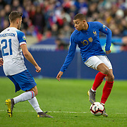 PARIS, FRANCE - March 25:  Kylian Mbappé #10 of France defended by Arnor Ingvi Traustason #21 of Iceland during the France V Iceland, 2020 European Championship Qualifying, Group Stage at  Stade de France on March 25th 2019 in Paris, France (Photo by Tim Clayton/Corbis via Getty Images)