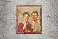 Roman fresco  portrait of a baker, Terentius, and his wife in the pose of intellectuals, Naples National Archaeological Museum , their expressions capture the sense of a real moment that connects with the viewer in a direct realistic way , Pompeii VII 2,6 , inv 9058 ,<br /> <br /> If you prefer to buy from our ALAMY PHOTO LIBRARY Collection visit : https://www.alamy.com/portfolio/paul-williams-funkystock - Scroll down and type - Roman Fresco Naples - into LOWER search box. {TIP - Refine search by adding a background colour as well}.<br /> <br /> Visit our ROMAN ART & HISTORIC SITES PHOTO COLLECTIONS for more photos to download or buy as wall art prints https://funkystock.photoshelter.com/gallery-collection/The-Romans-Art-Artefacts-Antiquities-Historic-Sites-Pictures-Images/C0000r2uLJJo9_s0