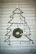 Christmas tree & wreath on a wall in Key West, Florida